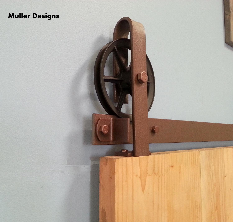 Spoked european top mount barn door hardware m ller designs for Top mount barn door hardware